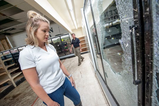 While talking about storm damage Monday, April 16, 2020, at Greer's grocery in Soso, Andee Thomas describes how the outer glass of a refrigerator door was sucked out and broken and the inner part of the two-pane glass was untouched. Her husband, Stephen Thomas, is a fifth-generation owner of Greer's, the only grocery in Soso. The store was hit hard when a tornado ripped through town Easter Sunday. The inventory is a total loss. The Greer's are waiting to hear about the building.