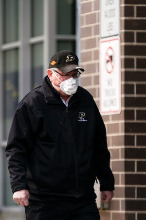 A man walks along North Second Street, Thursday, April 16, 2020 in Lafayette.
