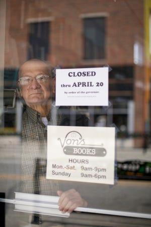 John von Erdmannsdorff, owner of Von's Shops, stands inside the doorway to the State Street business, Thursday, April 16, 2020 in West Lafayette.