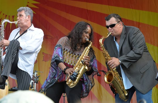 NEW ORLEANS, LA - APRIL 27:  Billy Joel horn section, Mark Rivera, Crystal Taliefero and Carl Fischer perform during the 2013 New Orleans Jazz & Heritage Music Festival at Fair Grounds Race Course on April 27, 2013 in New Orleans, Louisiana.