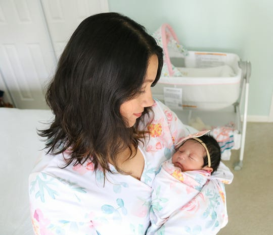 Debora Garcia and her newborn daughter, Elena Grace. Garcia gave birth to Elena at Baptist Health Louisville April 6 while still recovering from COVID-19.