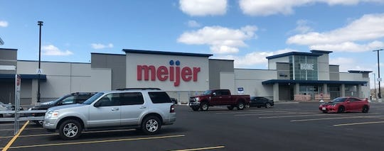 Vehicles are parked at the Manitowoc Meijer parking lot, but the store won't open in April as originally announced.