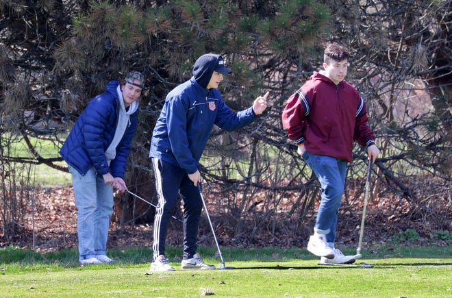 From left, Ganger Torbica, his twin brother, Promethius Torbica, and friend Andres Torres play a round of golf at Lake Park Golf Course in Milwaukee on Thursday, April 16, 2020.  Gov. Tony Evers extended his order to stay at home until May 26. Under the new rules, golf courses may open and businesses considered not to be essential may conduct minimum operations.