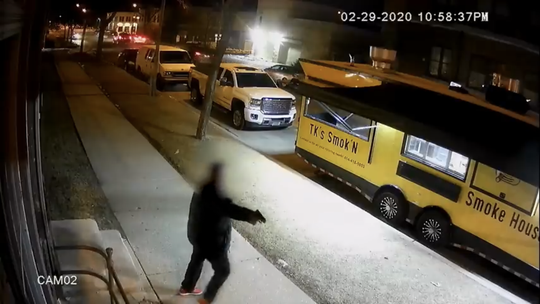 Anthony Taylor, 49, of Milwaukee is seen in surveillance footage provided by police pointing a gun at two officers outside a bar in the 300 block of West Reservoir Avenue. Police shot and killed Taylor moments later.