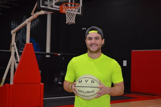 "Ryan ""NEON"" Citro is a Milwaukee Bucks' Rim Rocker, a personal trainer at Bridgewater Performance, and the head diving coach at Oak Creek High School."