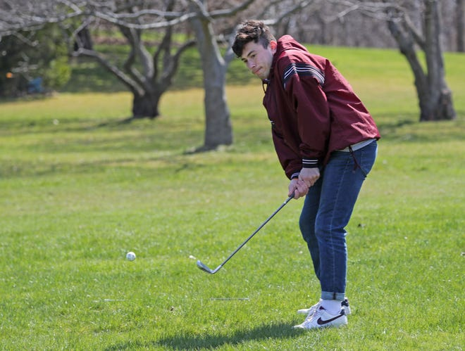 Andres Torres plays a round of golf at Lake Park Golf Course. Some area golf courses will open Friday.