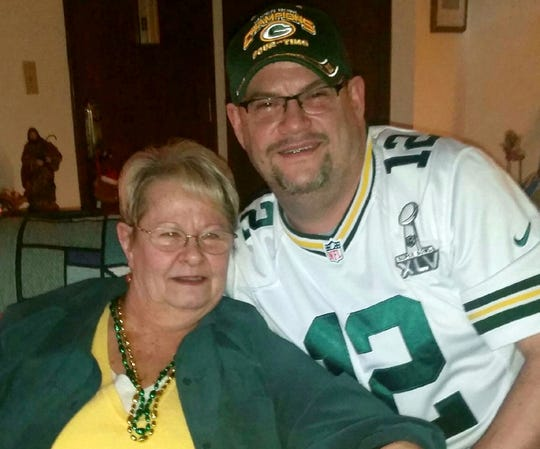 Mark Weber is shown with his mother, Candace Weber.