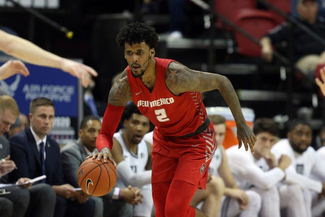 New Mexico's Vance Jackson plays against Utah State during the first half of a Mountain West Conference tournament game on March 5, in Las Vegas.