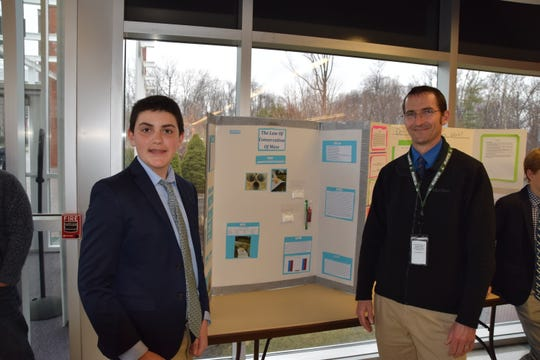 Delbarton student Justin Allen and biology teacher Brian Theroux explore the school's first science fair in April 2020.
