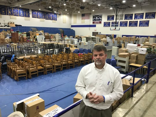 Donelson Christian Academy Headmaster Keith Singer in the school gym being used as a storage area on April 15, 2020, after the school was hit by a tornado on March 3, 2020.