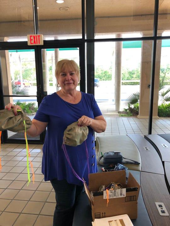 Nancy Frye delivers the masks she made.