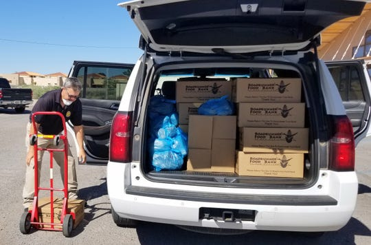 Luna County Sheriff Kelly Gannaway loaded 117 food boxes for delivery to home-bound senior citizens. County and multi-agency volunteers are assisting the Deming Senior Citizen's Center during the COVID-19 pandemic.