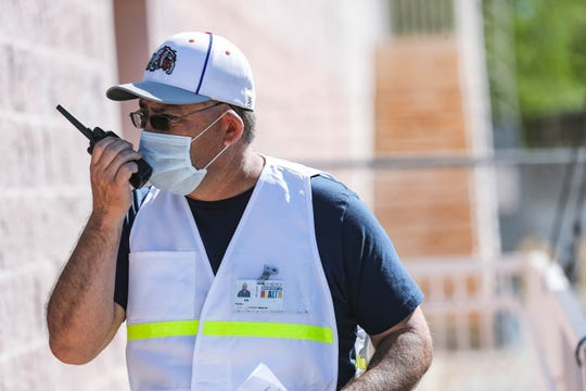 Gil Padilla works at a drive-thru coronavirus testing in Las Cruces at the Doña Ana County Heath Services Center on April 16, 2020.
