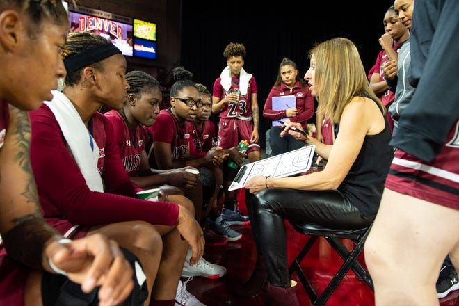 Brooke Atkinson signed three transfers on Wednesday for the New Mexico State women's basketball team.