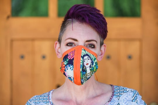 Genni McMahon makes custom masks from home for her friends and family.  McMahon is pictured at her home in Mesilla on Thursday, April 16, 2020.