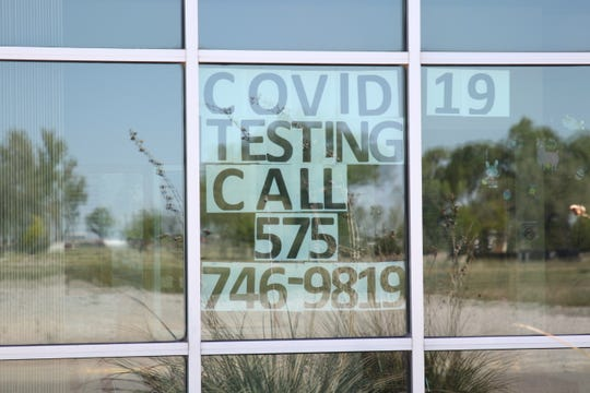 A sign in the window at the Eddy County Public Health Office in Artesia reminds residents on April 16, 2020 to call for COVID-19 testing.