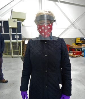 Livonia Mayor Maureen Miller Brosnan wearing a face shield donated to the city by AlphaUSA.