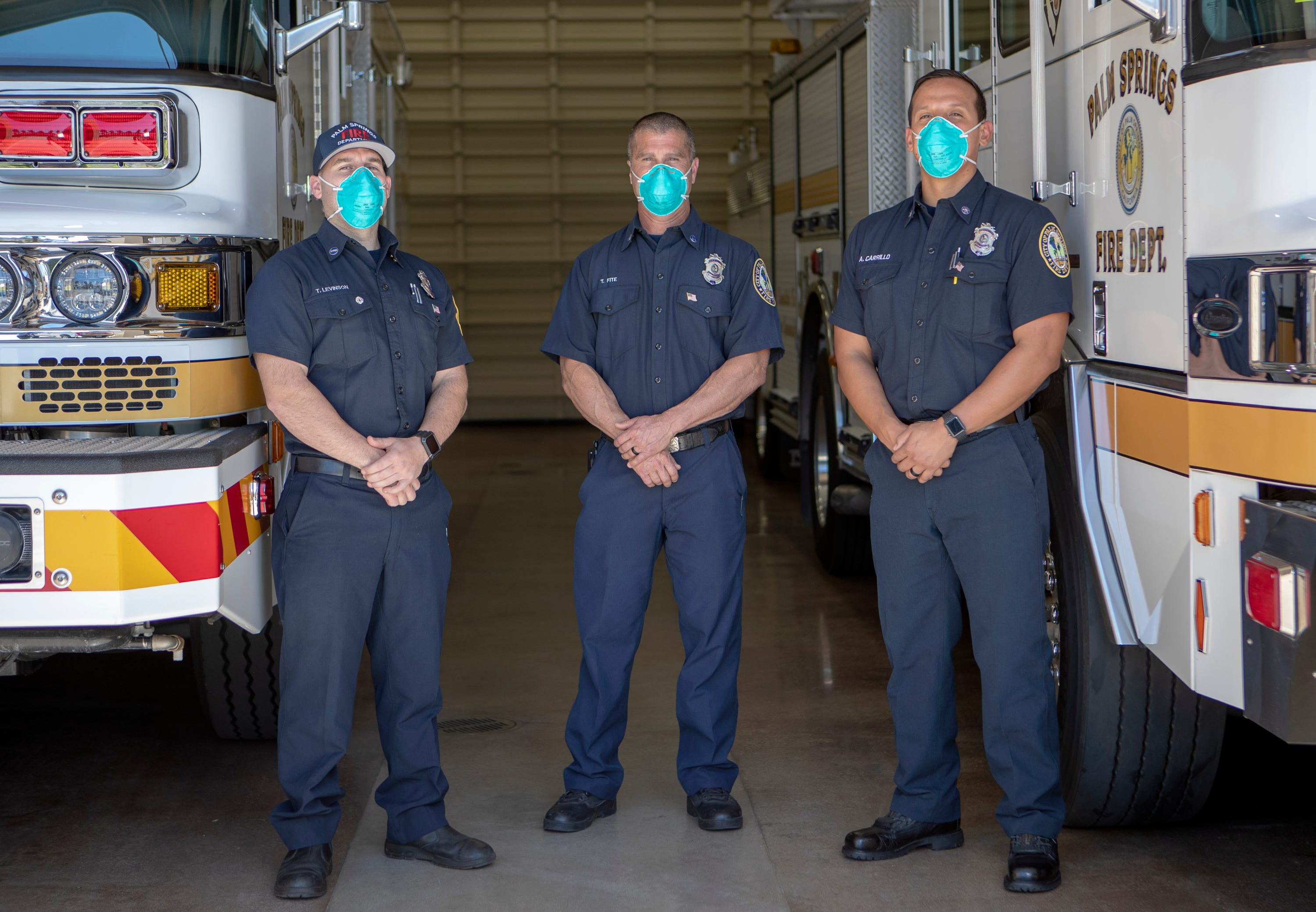 Palm Springs Fire Department Engineer Travis Levinson, left, Captain Todd Fite and Firefighter Alberto Carrillo are photographed inside Station 4 in Palm Springs, Calif., on Wednesday, April 15, 2020.
