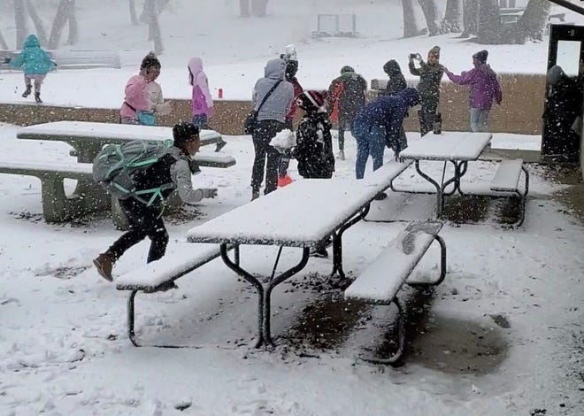 A group of kids visit Skyland Ranch in November 2019 and experience snow for the first time.