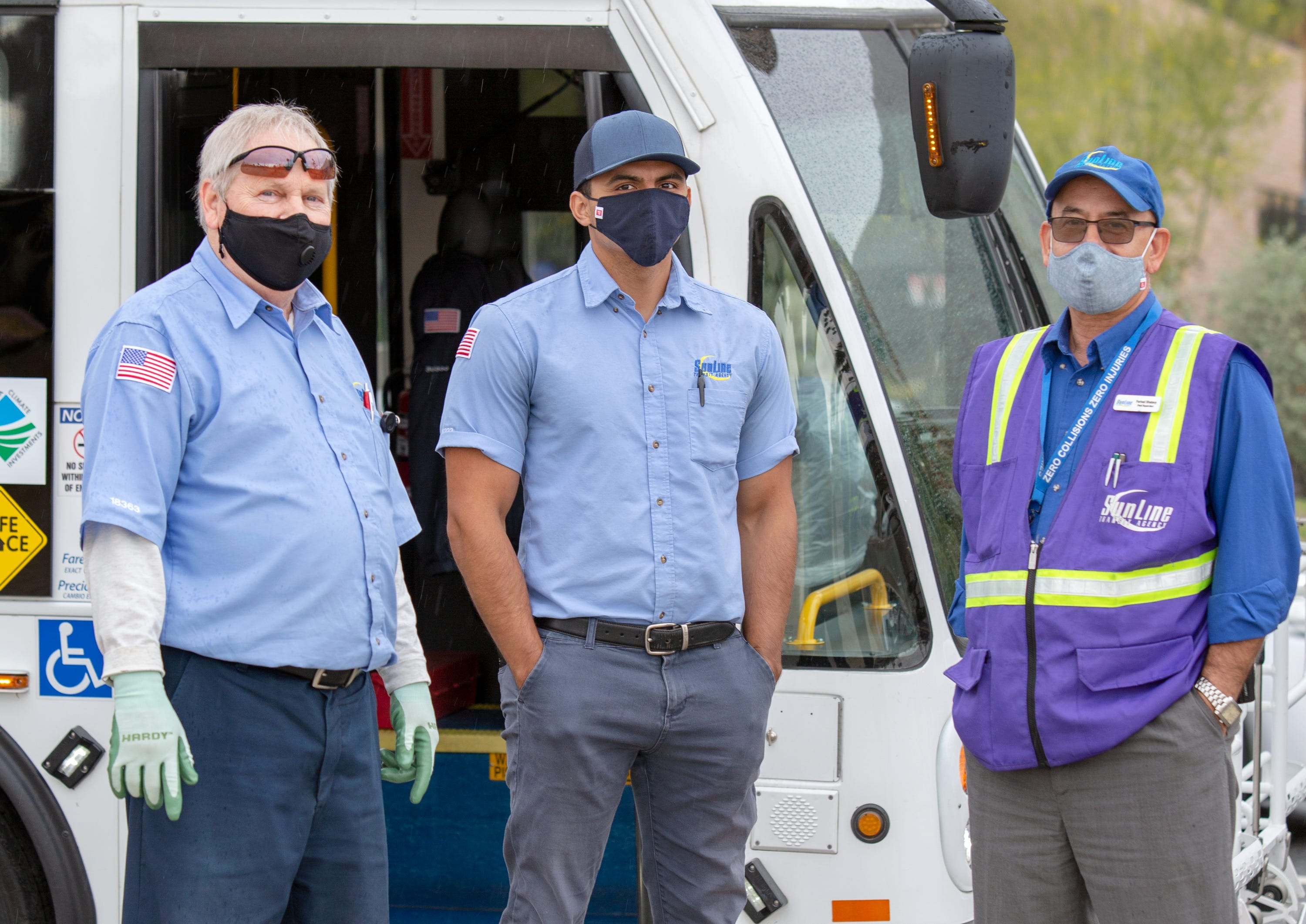 Transit operator Dean Richards, left, Christopher Gomez and field supervisor Farhad Shatavy are deemed essential workers during the coronavirus pandemic.