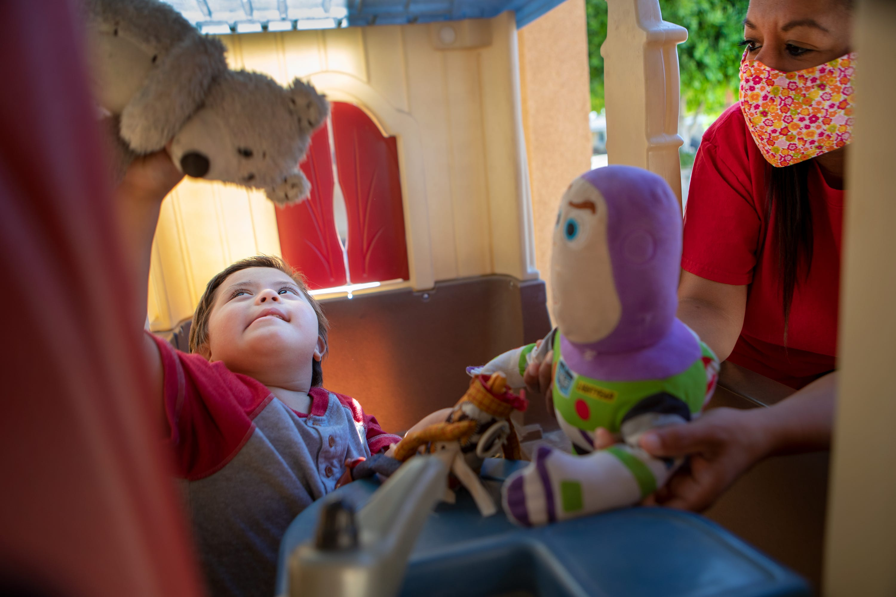 United Cerebral Palsy respite worker Yanira Regla plays with four-year-old Ezekiel Regla-Cuevas outside his home in Coachella, Calif., on Thursday, April 16, 2020. Regla currently has three clients that she sees for a total of twenty-four hours a month.
