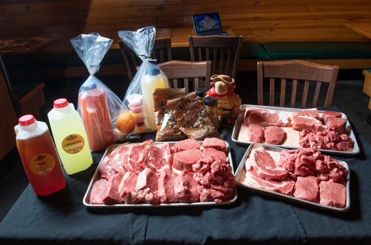 A variety of items including butcher packs, tea, lemonade, and margarita kits are being sold at Texas Roadhouse on North Davis Highway in Pensacola on Thursday, April 16, 2020.  The restaurant will be having a drive-thru farmer's market from 9 a.m. to 2 p.m. on Saturday.  A portion of those proceeds will go toward funding a free luncheon on Tuesday for out of work hospitality workers.