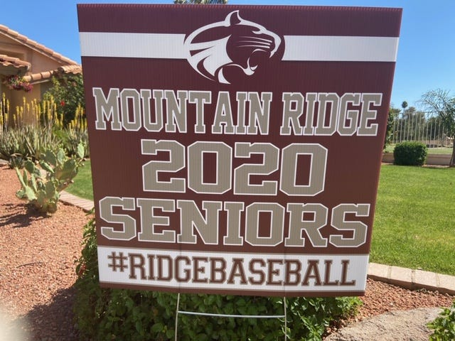 A sign in front of the Stancato home celebrating the senior seasons for Glendale Mountain Ridge twins Keegan and Kyler Stancato.