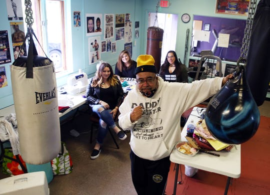 Anthony Bongiorni, owner of Floyd Patterson Boxing Club in Highland, is allowing Jamie Palamino, along with her friends Sara Pagan and Prisilla Acosta, to make surgical masks for healthcare workers at his club.