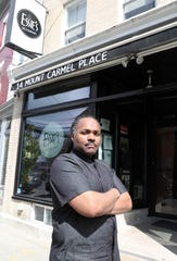 Brandon Walker, owner of Essie's Restaurant stands outside his Poughkeepsie business April 15, 2020. Local restaurants have taken an economic hit from the coronavirus.