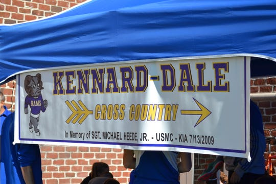 The Kennard-Dale cross country team has brought banners honoring Sgt. Michael Heede to meets throughout the years. Heede was killed in action while serving in Afghanistan in 2009.