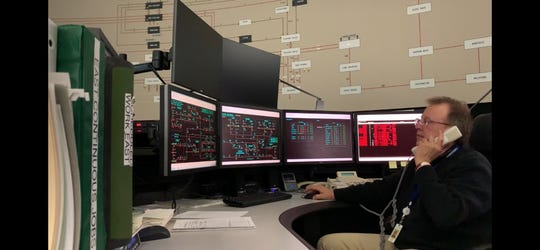 One of the National Grid employees sequestered at a utility location in Syracuse monitors screens.