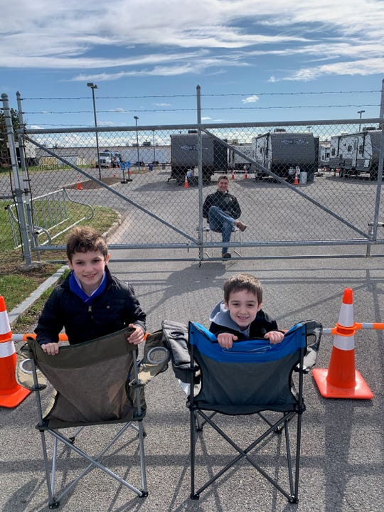 The children of a National Grid employee come to the utility's site in Syracuse where 50 employees are sequestered for one month to have a socially distant conversation with their father.