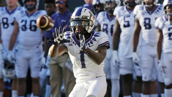 TCU wide receiver Jalen Reagor (1) reaches for a pass in the second half of an NCAA college football game against Oklahoma State in Stillwater, Okla., Saturday, Nov. 2, 2019.