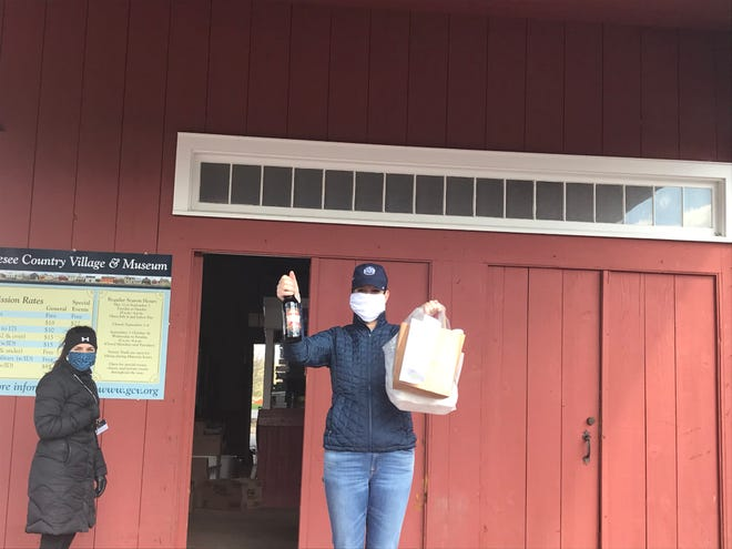 Becky Wehle, CEO of Genesee Country Village and Museum in Mumford, delivers touchless treats curbside.