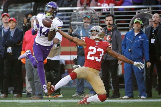 Minnesota Vikings wide receiver Stefon Diggs (14) catches a touchdown pass in front of San Francisco 49ers cornerback Ahkello Witherspoon (23) during the first half of an NFL divisional playoff football game, Saturday, Jan. 11, 2020, in Santa Clara, Calif. The Vikings traded Diggs to the Buffalo Bills during the offseason.