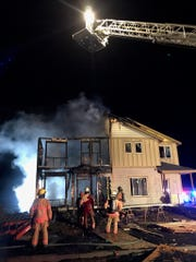 """Firefighters are asking the public for information about a """"suspicious"""" two-story house fire Wednesday nightin Dallas."""