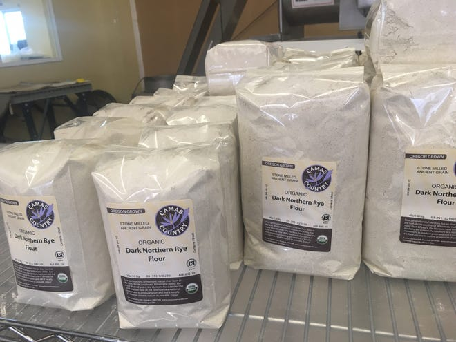 Flours on display at Camas Country Mill in Junction City.  Faced with increased demand for flour, the mill has diverted staff from their on-site bakery to keep up.