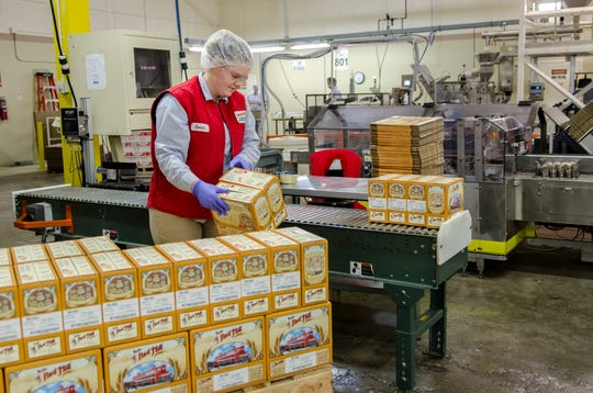 A worker stacks packages on a pallet at Bob's Red Mill in Milwaukie. This image taken prior to COVID-19 related mask recommendations.
