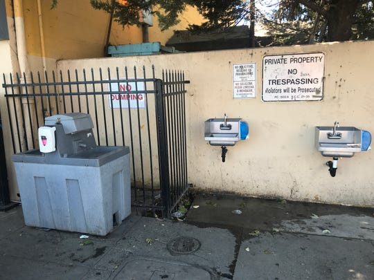 Two sinks were recently installed at Dorothy's Place in Chinatown. They sit next to a hand washing station provided by the city.