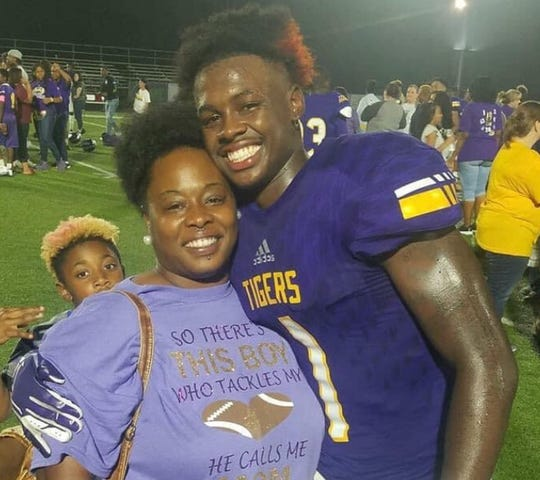 Logansport's Key'Savalyn Barnes shares a moment with his mother, Carria Barnes.