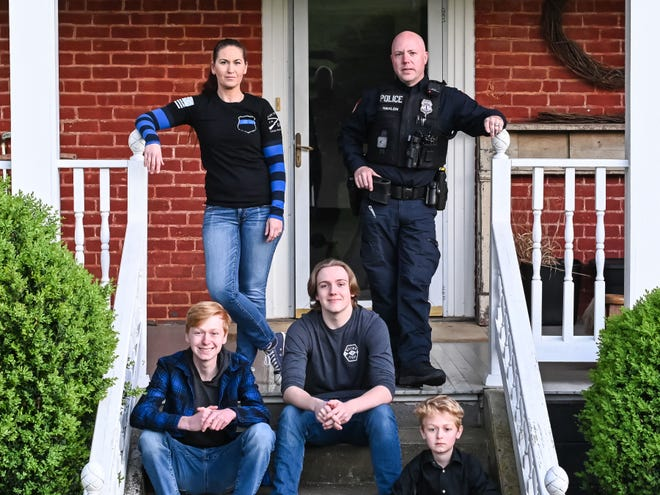 (Clockwise from top left) Tiffany and David Hanlon with sons Lochlain Hanlon, and Jackson and Wyatt Cash on their front steps. Tiffany Hanlon is a photographer collecting donations for The Front Steps Project.