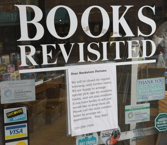 Books Revisted has a sign posted for its new business plan Wednesday, April 15, 2020, in St. Cloud.