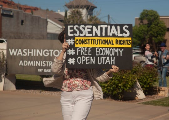 A protester displays a sign at the Washington County Administration Building to challenge state directives and express their desire to reopen businesses across the county.