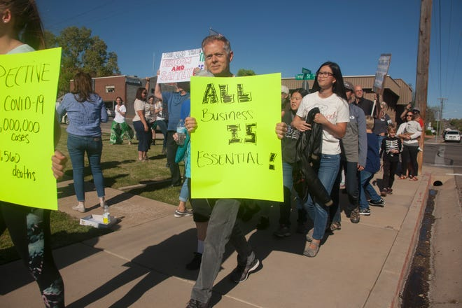 Community members gather at the Washington County Administration Building to challenge state directives and express their desire to reopen businesses around the county Wednesday, April 15, 2020.