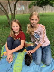 Deerlake Middle School teacher Erin Smidt adopted classroom pet PJ the guinea pig during the novel coronavirus pandemic in April, 2020. Here, her daughters pose for a photo with PJ.