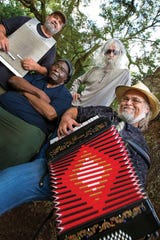 Bass guitarist Jiggs Walker, center, with Zydeco Zoo. Jiggs died on April 3.