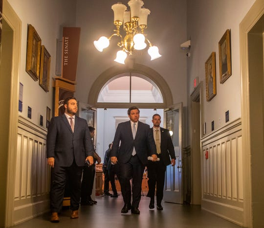 Gov. Ron DeSantis leaves an April 16 press conference held in the Historic Capitol in Tallahassee.