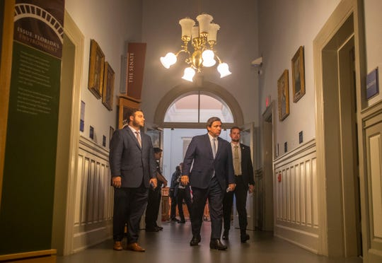 Gov. Ron DeSantis leaves a press conference held in the Historic Capitol, Thursday, April 16, 2020.
