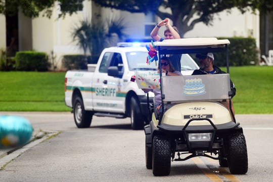 To celebrate his 11th birthday, Brady Rittenhouse was greeted by a parade of cars filled with friends and neighbors on Thursday, April, 16, 2020, as they honked horns, tossed birthday gifts from windows and slowly rolled past his Cypress Lake home in Indian River County. The parade was led by Indian River County Sheriff's Office vehicles with lights and sirens.