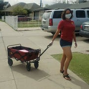 Denise Zavala uses precautions to deliver her Tacograms around El Paso.
